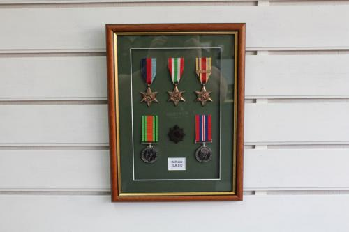 Set of WW2 medals and cap badge.