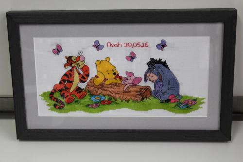 X-stitch Tigger, Winnie the Pooh, and Eeyore .