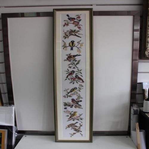 Long panel of hand embroidered birds.